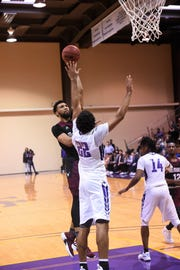 McMurry's Mike Williams Jr. (22) goes over HSU's Neal Chambliss (22) for a shot at the Mabee Complex on Saturday, Jan. 26, 2019. The War Hawks won 75-70.