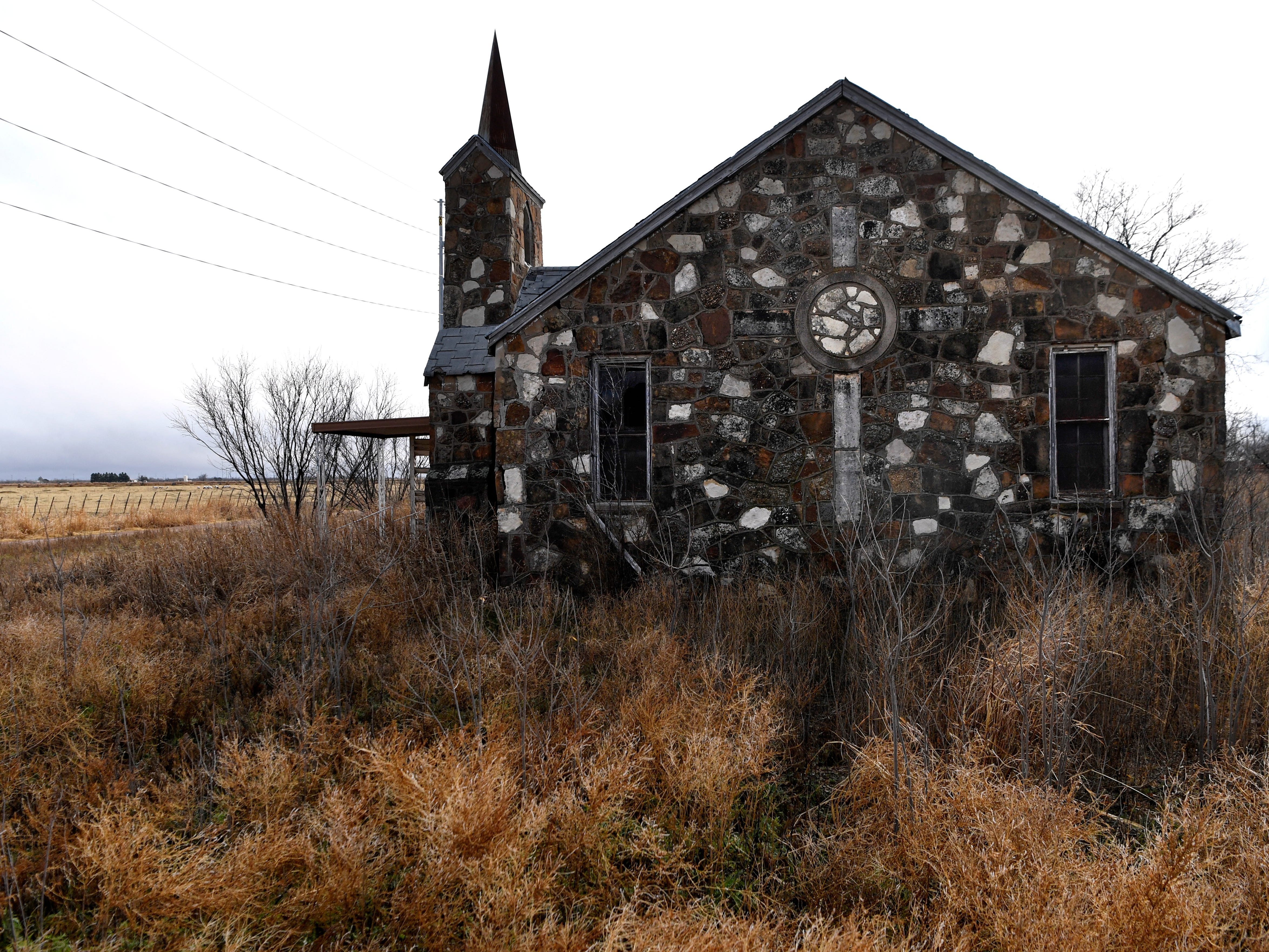 The north side of an abandoned field stone church in Truscott Dec. 26, 2018, where a Celtic cross was inset into the wall.