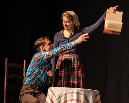 Billy (Tristan Riley) has his book held for ransom by Helen (Rose Burt).