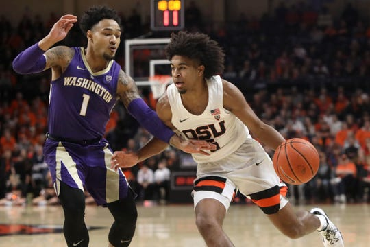 Oregon State's Ethan Thompson, right, is guarded by Washington's David Crisp (1) during the first half of an NCAA college basketball game in Corvallis, Ore., Saturday, Jan. 26, 2019.