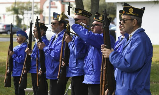 The North Brevard Honor guard stands at attention as Taps is played during the Astronaut Memorial Ceremony at Sand Point Park in Titusville
