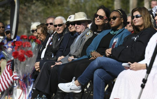 Special guests and former Kennedy Space Center workers listen to the speakers during Saturday's Astronaut Memorial Ceremony at Sand Point Park in Titusville.