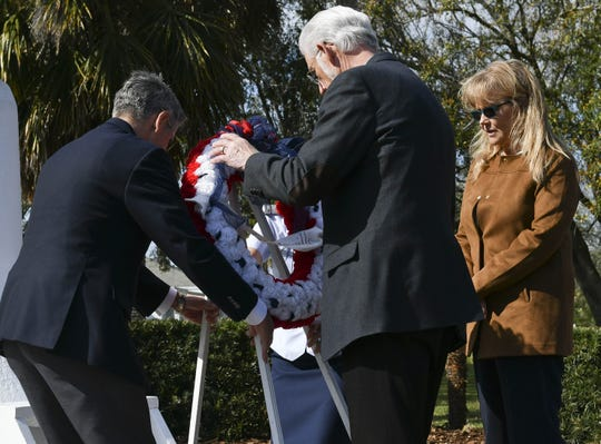 Former KSC Director Robert Cabana, Titusville Mayor Walt Johnson and county commissioner Rita Pritchett lay a wreath at the Astronaut Memorial during Saturday's ceremony at Sand Point Park in Titusville