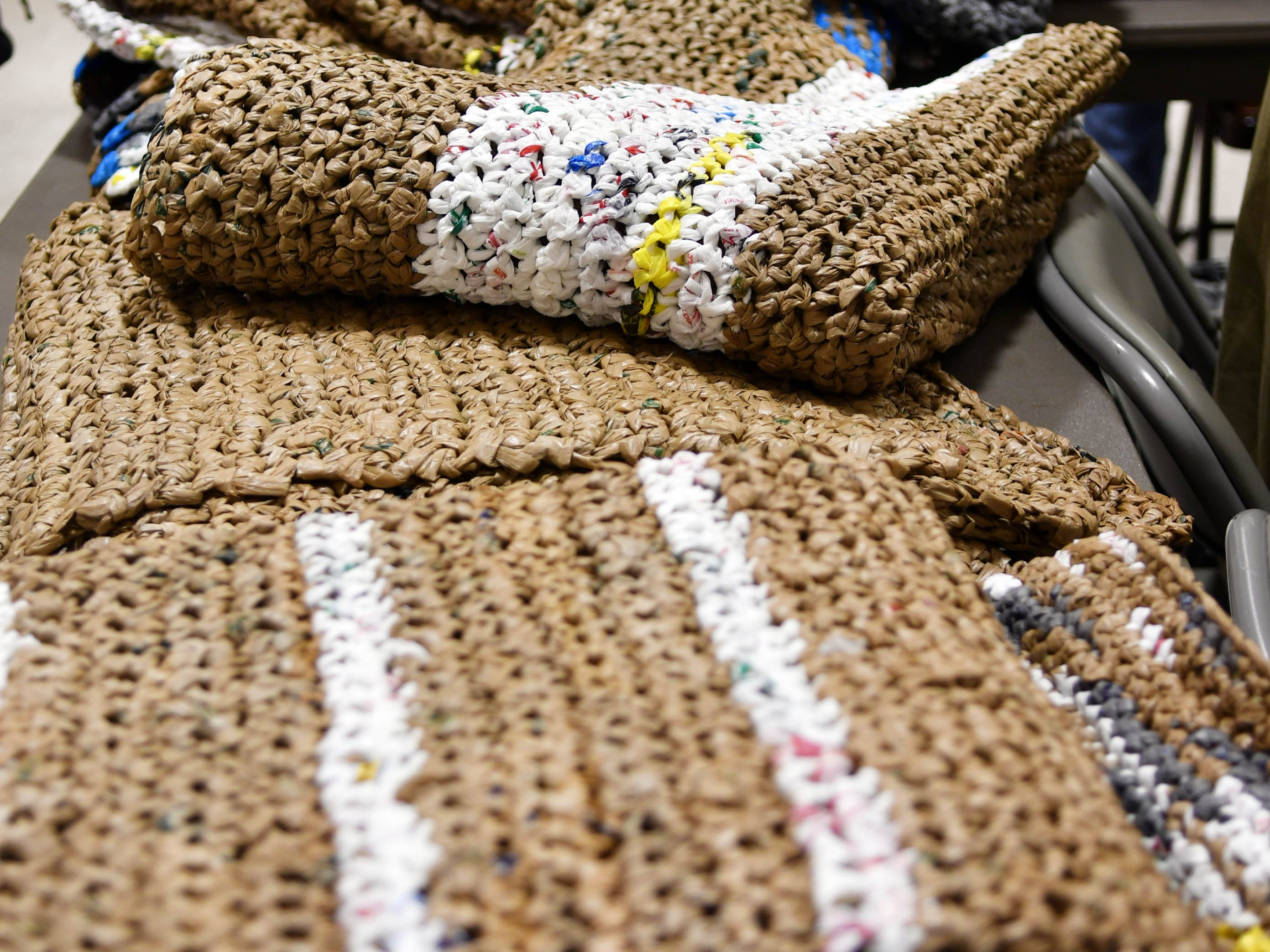 Ground mats made from recycled plastic bags await distribution during Saturday's Stand Down for Veterans at Cocoa Armory.