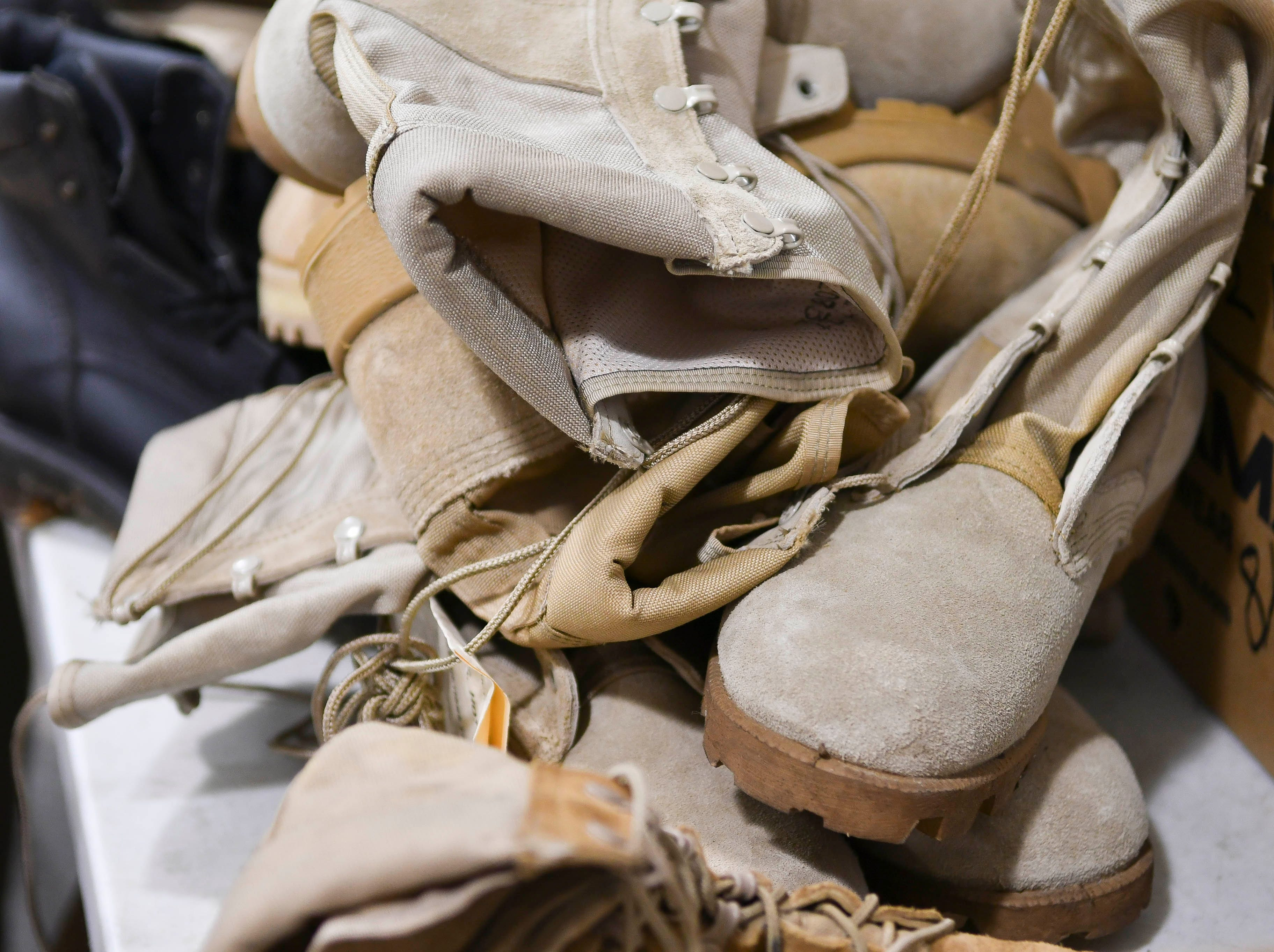 Shoes are piled up to distribute to homeless veterans during Saturday's Stand Down for Veterans at Cocoa Armory.