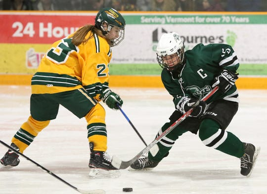 Rice Memorial's Lisa McNamara and BFA-St. Albans Elizabeth Dukas vie for control of the puck in the Comets' 2-0 win over the Green Knights on Saturday night, Jan. 26 at the Collins-Perley Sports Complex in St. Albans.