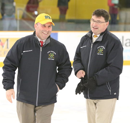 BFA-St. Albans head coach Luke Cioffi, left, and assistant Jeff Rouleau are all smiles after the duo won their 300th game as the coaches of the Comets on Saturday night, Jan. 26, 2019 at the Collins-Perley Sports Complex. The BFA-St. Albans girls high school celebrate the program's 300th win on Saturday, Jan. 26, 2019 at the Collins-Perley Sports Complex. The Comets achieved the feat with a 2-0 win over visiting Rice Memorial.