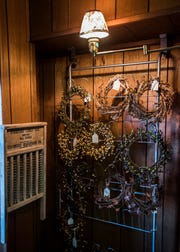 Homemade wreaths surrounded by an old washboard and light capture the vintage essence of what Patty Malone is trying to create at her Patty's Primitive and Antiques store.