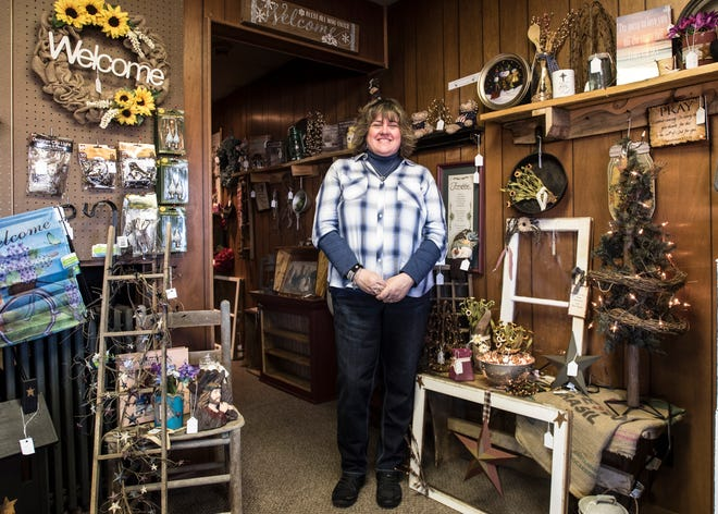 Chillicothe native Patty Malone stands in the middle of her new store Patty's Primitives and Antiques store on 4th street in Downtown Chillicothe. Along with products form local vendors, the shop includes homemade crafts, antiques, cookware and other unique items