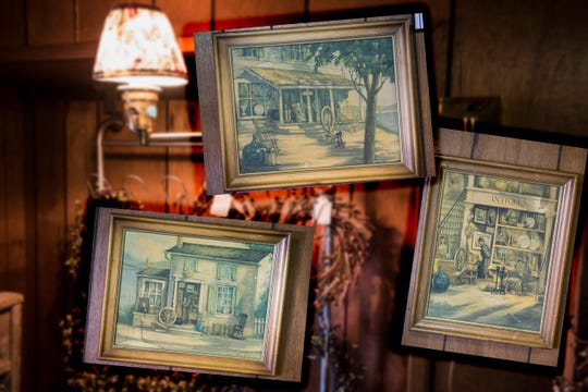 Pictures from an estate auction hang inside the antique store from childhood neighbor Ed Salley. Salley was one of the first people to encourage Patty Malone to open her own business.