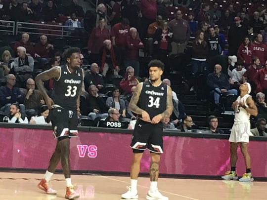 Jarron Cumberland (34) helped Nysier Brooks (33) get a win in his hometown of Philadelphia Sunday. Cumberland had 23 in UC's 72-68 come from behind win at Temple.