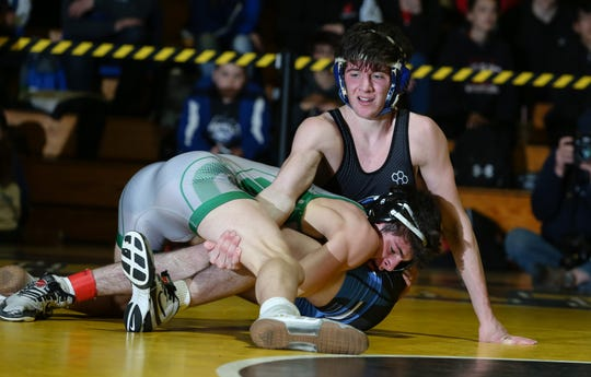 South Plainfield's Alex Amato wrestles Middlesex's Troy O'Connor in the 138-pound final
