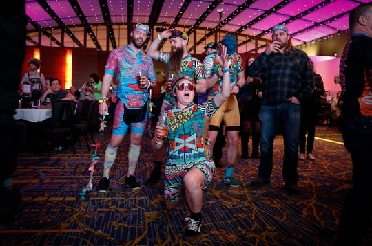 Cyclists dance as the Brazilian 2wins perform during the RAGBRAI route announcement party at the Iowa Events Center in Des Moines on Saturday, Jan. 26, 2019.