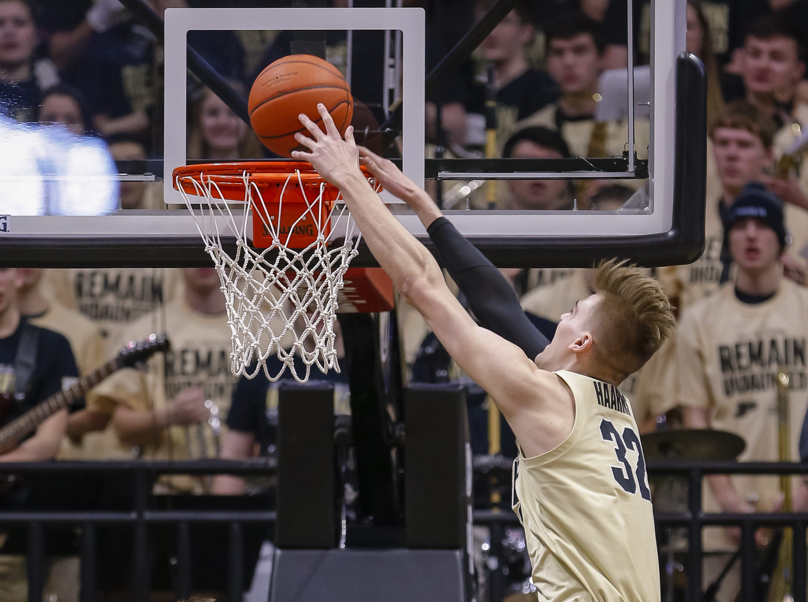 Purdue center Matt Haarms dunks the ball over Michigan State guard Matt McQuaid during the first half on Sunday, Jan. 27, 2019, in West Lafayette, Ind.