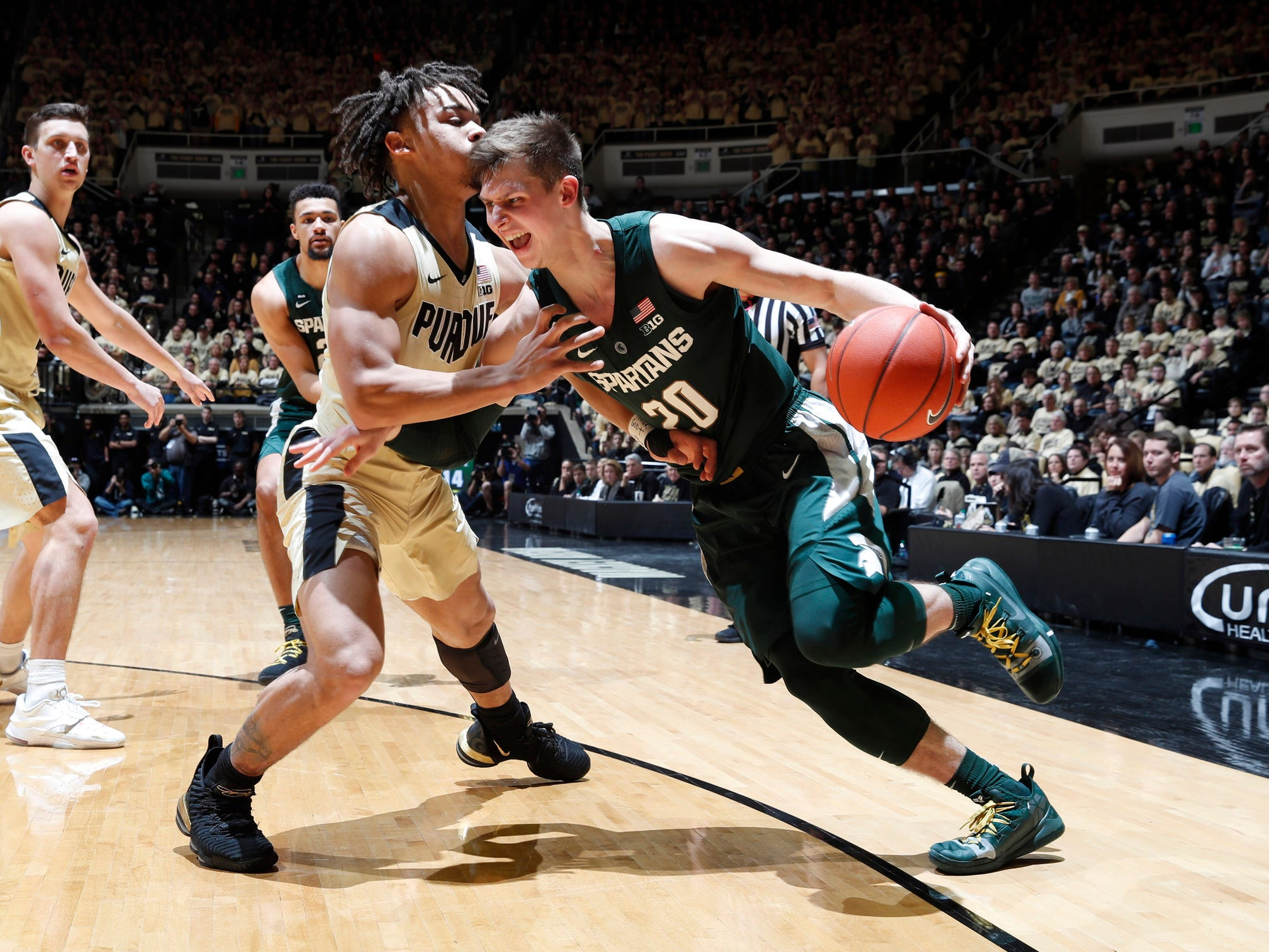 Michigan State guard Matt McQuaid dribbles the ball as Purdue guard Carsen Edwards defends during the first half on Sunday, Jan. 27, 2019, in West Lafayette, Ind.