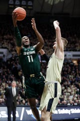 Michigan State forward Aaron Henry shoots over Purdue center Matt Haarms during the first half on Sunday, Jan. 27, 2019, in West Lafayette, Ind.