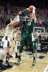 Michigan State guard Matt McQuaid shoots over Purdue guard Carsen Edwards during the first half on Sunday, Jan. 27, 2019, in West Lafayette, Ind.