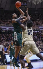 Michigan State forward Nick Ward shoots the ball against Purdue center Trevion Williams during the first half on Sunday, Jan. 27, 2019, in West Lafayette, Ind.