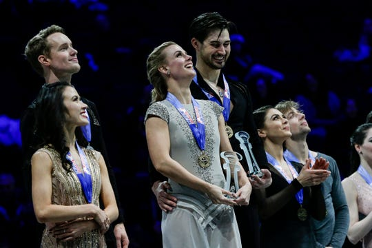 Madison Hubbell and Zachary Donohue, center, who won first place, stand next to second-place finishers Madison Chock and Evan Bates, left, and third-place finishers Kaitlin Hawayek and Jean-Luc Baker during the ice dance awards ceremony of the 2019 U.S. Figure Skating Championships at Little Caesars Arena in Detroit on Jan. 26, 2019.