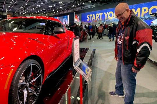 Bruce Gorman, 63, of Livonia checks out the cars on display at the 2019 North American International Auto Show at Cobo Center on Jan. 27, 2019. Gorman said he's been coming to the annual event for 30 years.