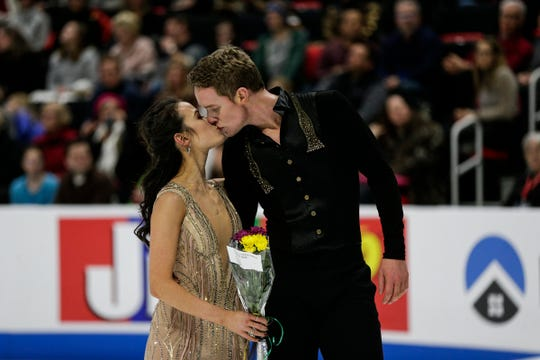 Madison Chock kisses Evan Bates after their free dance performance during the 2019 U.S. Figure Skating Championships at Little Caesars Arena in Detroit on Jan. 26, 2019.