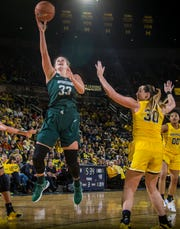 Michigan State center Jenna Allen attempts a layup while defended by Michigan center Hallie Thome in the second half of MSU's 77-73 win on Sunday, Jan. 27, 2019, at Crisler Center.