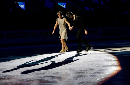 Ice dance winners Madison Hubbell and Zachary Donohue skate across the ice before the award ceremony during the 2019 U.S. Figure Skating Championships at Little Caesars Arena in Detroit on Jan. 26, 2019.
