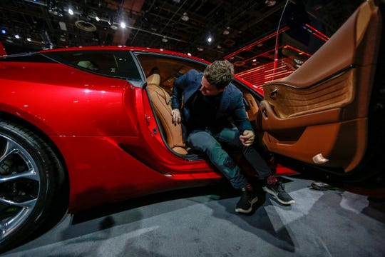 Justin Maranger, 32, of Toronto steps out of the 2019 Lexus LC500 Coupe during the North American International Auto Show at Cobo Center in downtown Detroit on Saturday, Jan. 19, 2019.