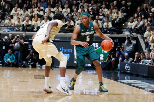 Jan 27, 2019; West Lafayette, IN, USA; Michigan State Spartans guard Cassius Winsotn (5) dribbles the ball as Purdue Boilermakers guard Eric Hunter Jr. (2) defends during the first half at Mackey Arena. Mandatory Credit: Brian Spurlock-USA TODAY Sports