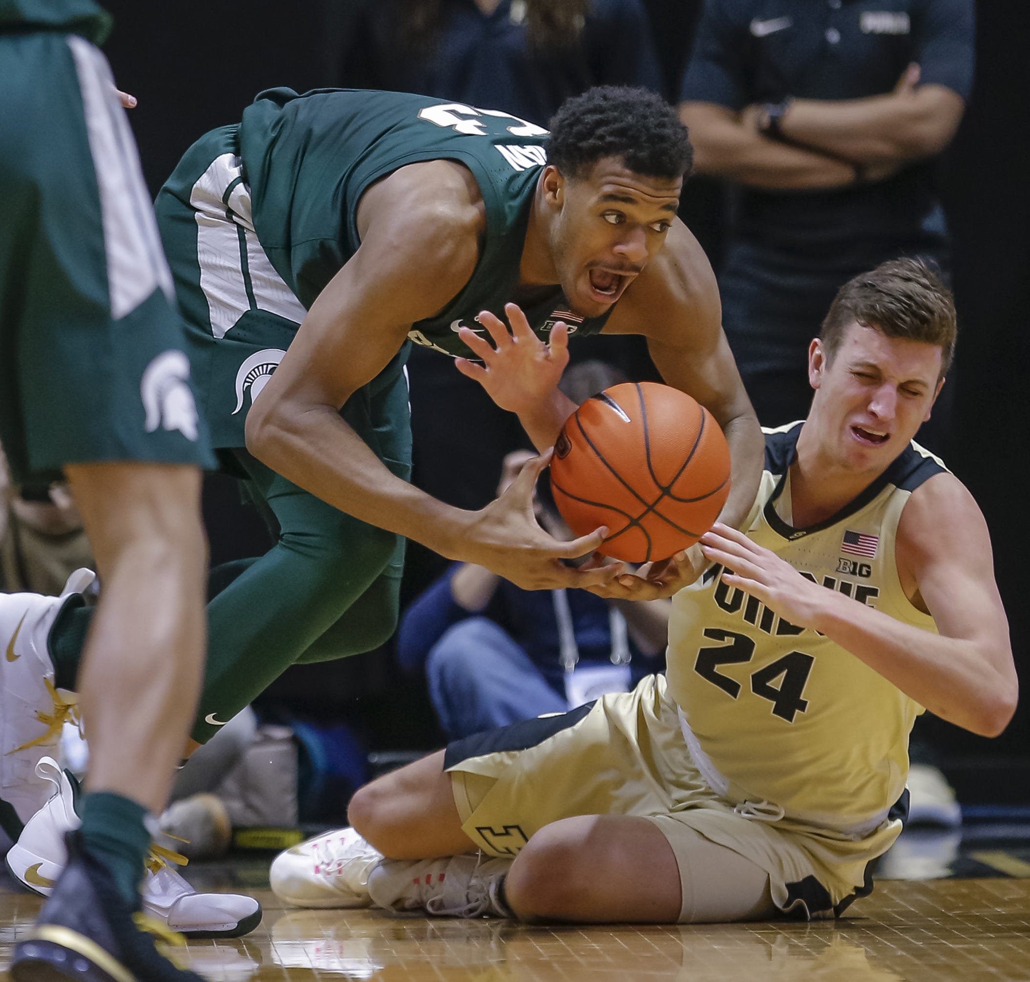 Michigan State forward Xavier Tillman and Purdue forward Grady Eifert battle for the loose ball during MSU's 73-63 loss on Sunday, Jan. 27, 2019, in West Lafayette, Indiana.