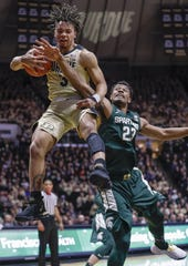 Purdue guard Carsen Edwards snags a rebound against Michigan State forward Xavier Tillman during the first half on Sunday, Jan. 27, 2019, in West Lafayette, Ind.