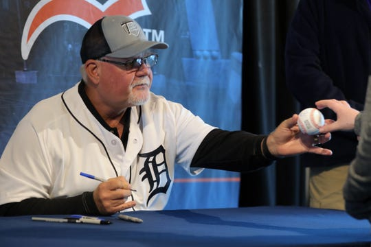 Tigers manager Ron Gardenhire signs autographs for fans during TigerFest at Comerica Park, Jan. 26 in Detroit.