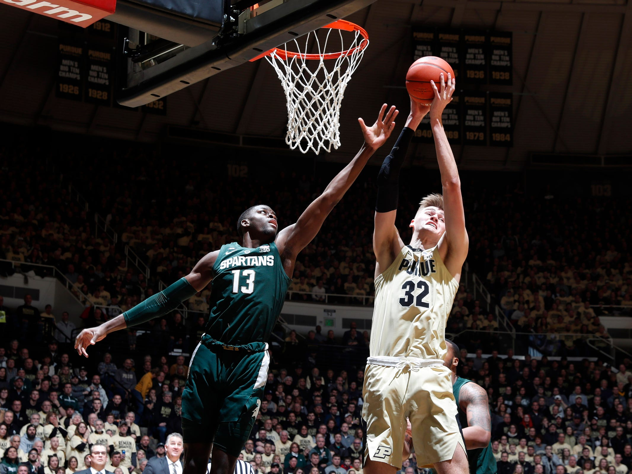 Michigan State forward Gabe Brown  battles for a rebound with Purdue center Matt Haarms during the first half on Sunday, Jan. 27, 2019, in West Lafayette, Ind.