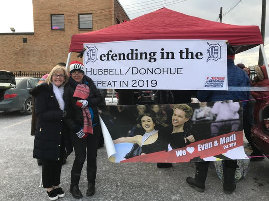 Nancy Bates, left, and Susan Hubbell, pose for a picture while tailgating before the 2019 U.S. Figure Skating Championships on Saturday, Jan. 26, 2019, in Detroit, Michigan. Bates' son, Evan, was set to compete against Hubbell's daughter, Madison, in Saturday's ice dance finals inside Little Caesars Arena.
