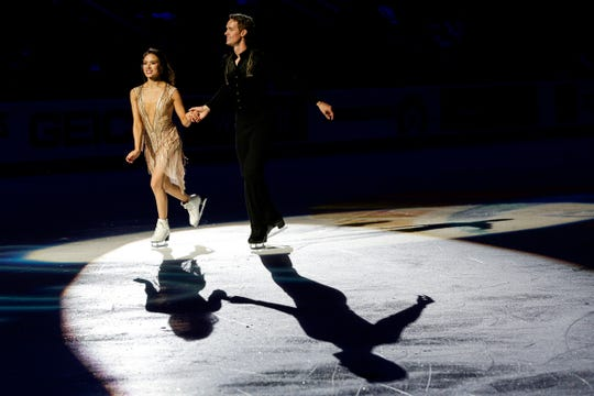 Free dance second place Madison Chock and Evan Bates skate across the ice before the award ceremony during the 2019 U.S. Figure Skating Championships at the Little Caesars Arena in Detroit, Saturday, Jan. 26, 2019.