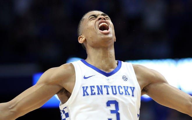 Kentucky's Keldon Johnson celebrates a 3-pointer during the second half Saturday.