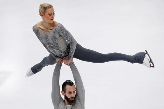 Ashley Cain and Timothy LeDuc perform during their pairs free skate program Saturday at the U.S. Figure Skating Championships at Little Caesars Arena in Detroit.
