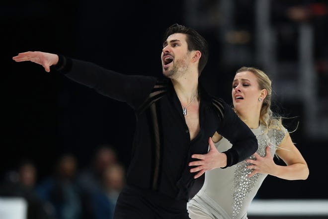 Madison Hubbell, who grew up in Okemos and lives in Ann Arbor, and Zachary Donohue successfully defend their title in the free dance competition Saturday during the U.S. Figure Skating Championships at Little Caesars Arena.