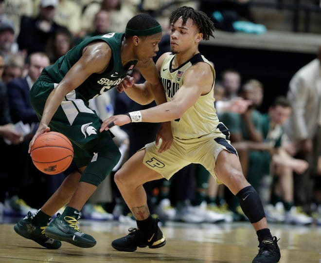 Purdue guard Carsen Edwards defends Michigan State guard Cassius Winston  during the second half.