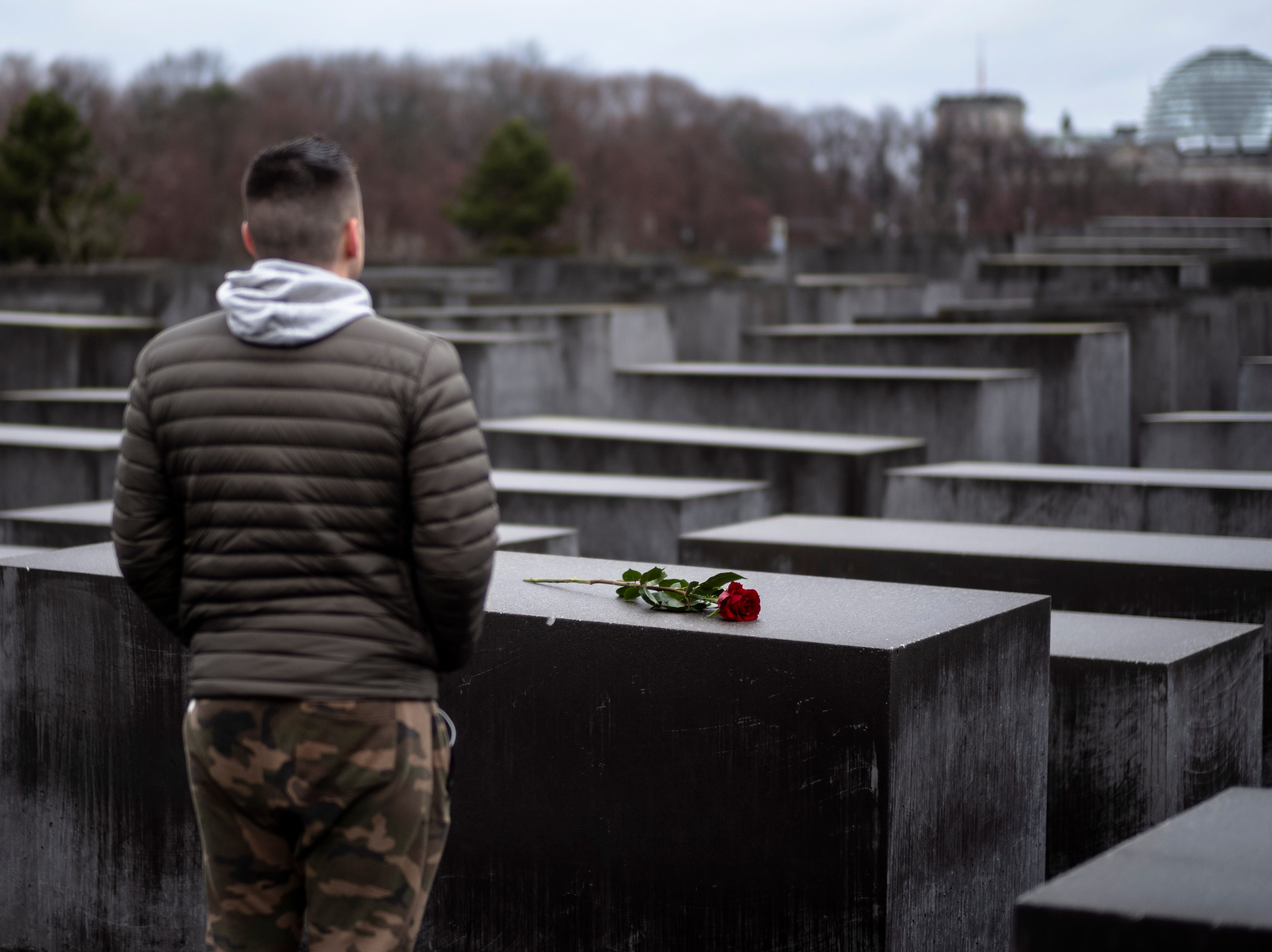 A young man stands in front of the Holocaust Memorial after he laid down a red rose on a slab of the memorial to commemorate the victims of the Nazis in Berlin, Sunday, Jan. 27, 2019. The International Holocaust Remembrance Day marks the liberation of the Auschwitz Nazi death camp on Jan. 27, 1945.