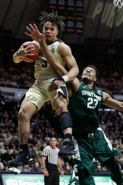 Purdue guard Carsen Edwards grabs a rebound over Michigan State forward Xavier Tillman during the first half.