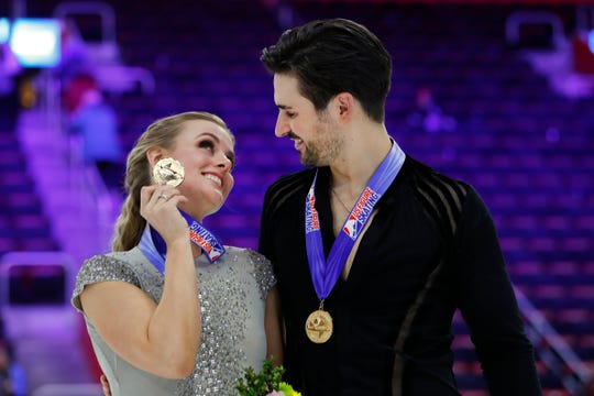 Madison Hubbell and Zachary Donohue celebrate with their gold medals for the ice dancing title.