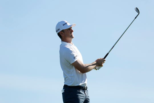 Justin Rose finished 3-under 69 Saturday to hold three-shot lead after the third round of the Farmers Insurance Open at the Torrey Pines Golf Course in San Diego.
