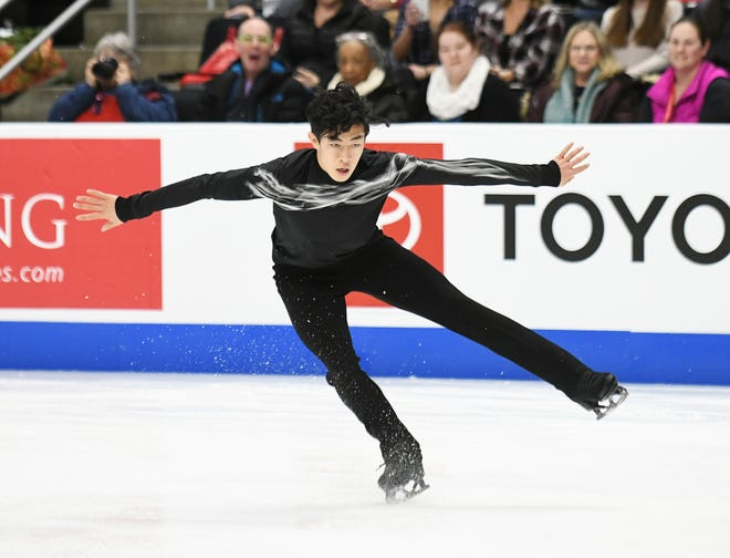 Nathan Chen lands a jump in the men's free skate at the U.S. Figure Skating Championships in Detroit on Sunday.