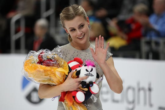 Madison Hubbell waves to fans after finishing her championship free dance.