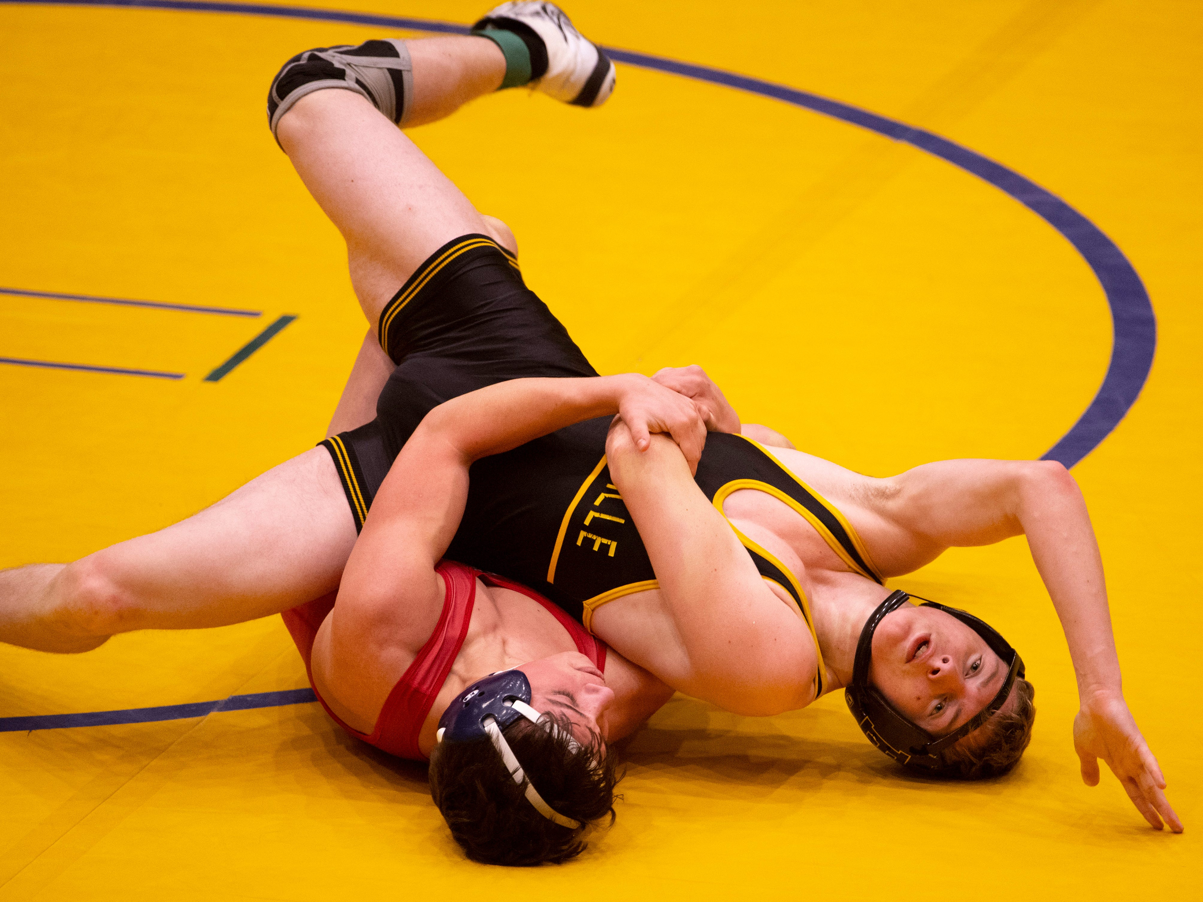 Boonville's Zach Davis, right, and Heritage Hills' Beau Heeke compete in the 132-pound championship match at the IHSAA Sectional at Castle High School Saturday afternoon. Heeke came out on top with a 4-0 win.