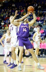 Northern Iowa's Luke McDonnell battles for a rebound with Evansville's Dainius Chatkevicius during action at the McLeod Center in Cedar Falls, Iowa, Saturday, Jan. 27, 2019.