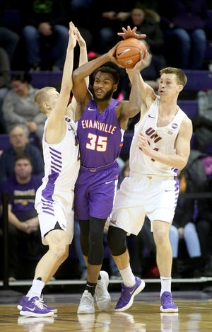 Northern Iowa's AJ Green, left, and Luke McDonnell pressure Evansville's John Hall during action at the McLeod Center in Cedar Falls, Iowa, Saturday, Jan. 27, 2019.