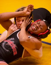 Boonville's Logan Sutton, top, competes against Harrison's Khaliq Boyd in the championship 113-pound match at the IHSAA Sectional at Castle High School Saturday afternoon. Sutton won a major decision 10-2.