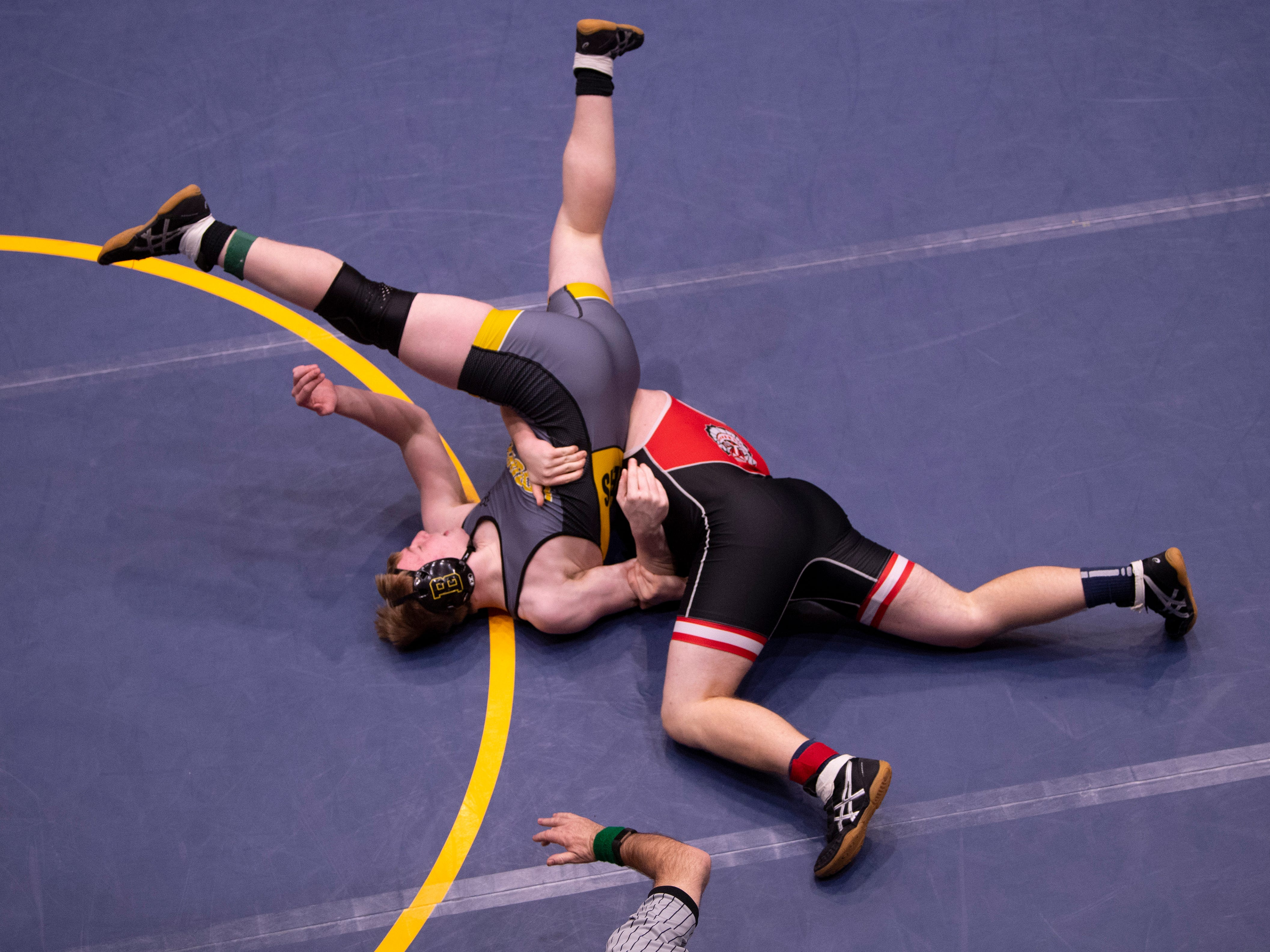 Boonville's Jackson Bell, left, is pinned by Harrison's Nate Greulich in their consolation match at the IHSAA Sectional at Castle High School Saturday afternoon. Greulich advanced to regionals with the win.